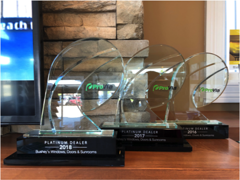 Photo of multiple Provia awards received by Bushey's