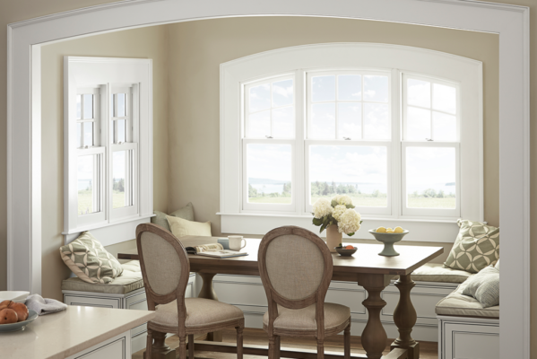 Breakfast nook with double hung windows